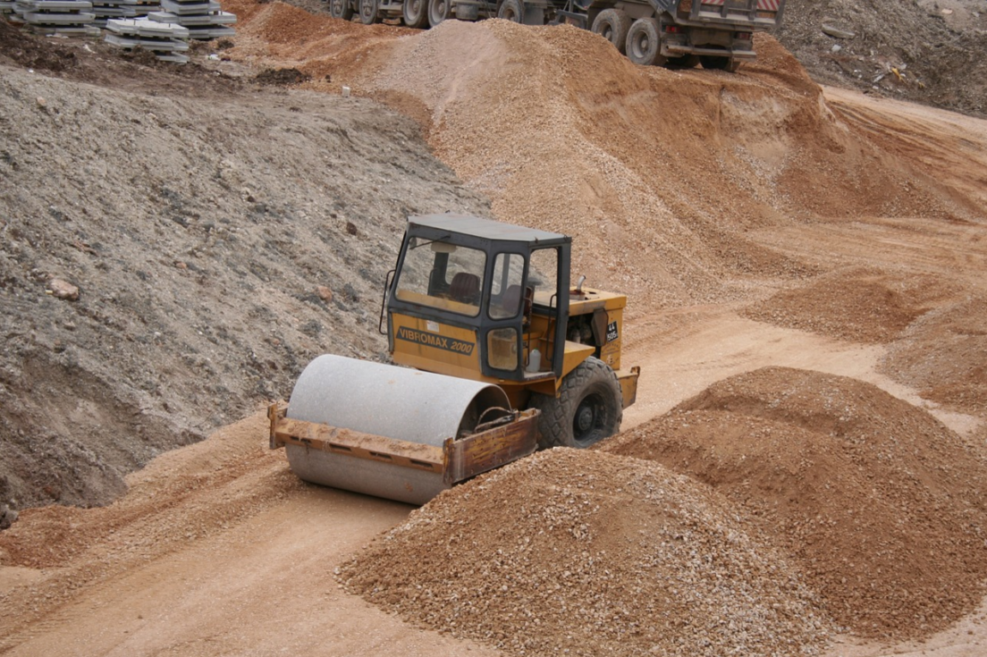 construction vehicle grading a surface