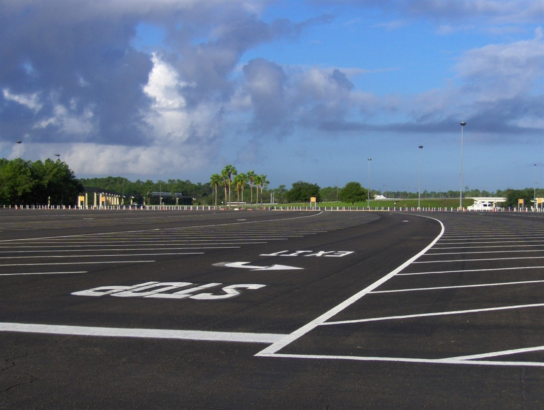 asphalt parking lot with parking stripes